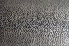 黑皮革的细节作为背景 免版税库存图片
