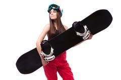 黑短的无袖衫举行雪板的年轻俏丽的妇女 库存图片
