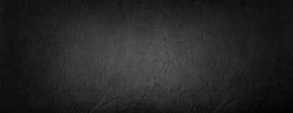 黑石背景,灰色水泥纹理 顶视图,平的位置 库存照片