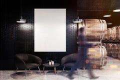 黑砖葡萄酒库、扶手椅子和海报,人 图库摄影