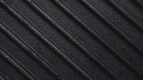 黑粗砺的生铁平板炉格栅平底锅有肋骨背景 免版税库存图片