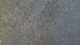 黑粗糙的与蓝色低音的沥青真正的织地不很细背景 免版税图库摄影