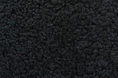 黑羊毛样品用皮革包盖缝合的布料 免版税库存照片