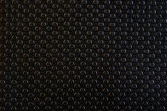 黑背景和抽象圈子样式,设计的表面 与圈子的深灰背景,为装饰完善 免版税库存图片