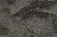 黑色上色花岗岩灰色表面 免版税库存照片