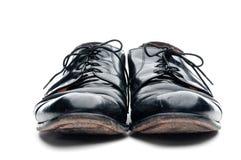 黑色企业皮革老对穿上鞋子破旧 免版税库存照片