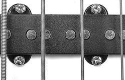 黑色低音乐器与紧张的字符串的吉他装货 免版税库存图片
