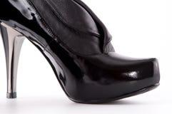 黑色停顿高鞋子 免版税库存图片