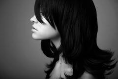 黑色典雅的女孩头发 免版税库存照片