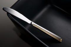 黑色刀子盘 库存照片
