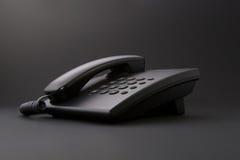 黑色办公室电话严重的工具 免版税图库摄影