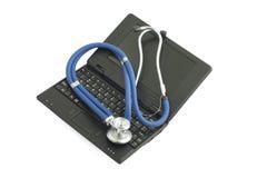黑色医疗netbook听诊器白色 免版税库存图片