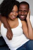 黑色夫妇微笑 免版税库存图片