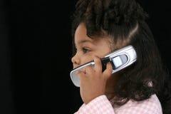 黑色女孩移动电话 图库摄影