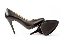 黑色女性皮革一个穿上鞋子绒面革二 库存图片
