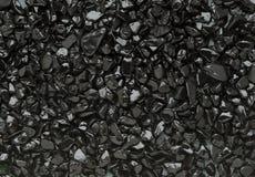 黑色小的石头 库存照片