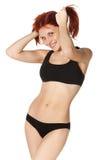 黑色快乐的女孩女用贴身内衣裤体育& 免版税库存图片