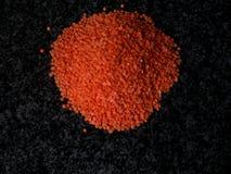 黑色扁豆使红色有大理石花纹 库存照片