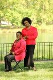 黑色更旧的户外二名妇女 免版税库存照片