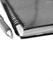 黑色构成笔记本笔白色 免版税图库摄影