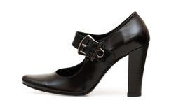 黑色查出的鞋子 库存照片