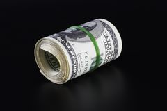 黑色查出货币卷 免版税库存照片