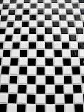 黑色棋盘铺磁砖白色 图库摄影