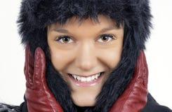 黑色毛茸的帽子冬天妇女年轻人 库存照片