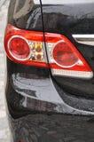 黑色汽车闪亮指示 库存图片