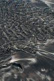 黑色沙子 免版税库存图片