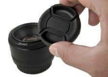 黑色照相机盖帽查出透镜 免版税库存照片
