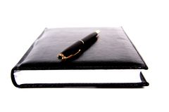 黑色物质笔记本笔 免版税库存照片