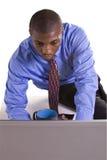 黑色生意人服务台他的工作 免版税图库摄影