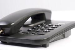 黑色电话 免版税库存图片