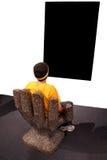 黑色男孩屏幕凝视 免版税图库摄影