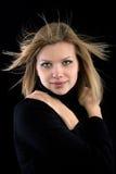 黑色白肤金发的女孩高领衫 免版税图库摄影