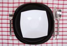 黑色的盘子白色 免版税图库摄影