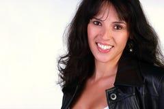 黑色皮革的美丽的妇女 免版税库存图片