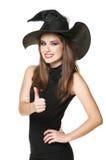 黑色礼服的新微笑的巫婆 库存照片