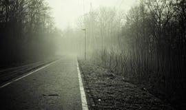 黑色空的路白色 库存图片
