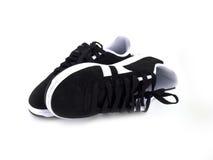 黑色穿上鞋子白色 库存图片