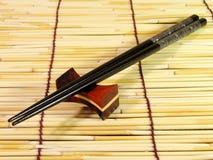 黑色筷子 免版税库存照片