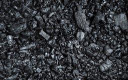 黑色纹理烧了与木日志的煤炭 库存照片