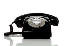黑色老减速火箭的电话 免版税库存图片