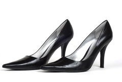 黑色脚跟高对s穿上鞋子妇女 免版税库存图片
