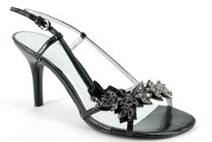 黑色脚跟高鞋子妇女 免版税库存图片
