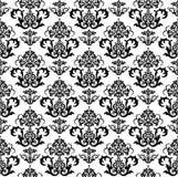 黑色花卉无缝的墙纸白色 免版税库存图片