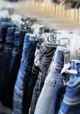 黑色蓝色停止的牛仔裤行 免版税图库摄影