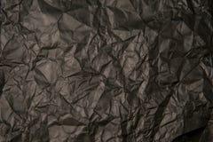 黑色被弄皱的纸纹理 库存照片