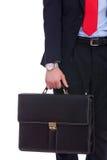 黑色诉讼现有量藏品公文包的商人 库存图片